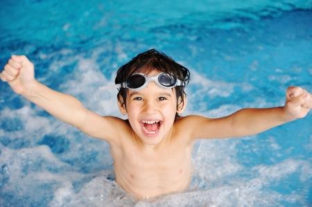 Super happy boy inside the swimming pool photo