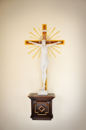 Jesus Christ on cross, wall in church photo