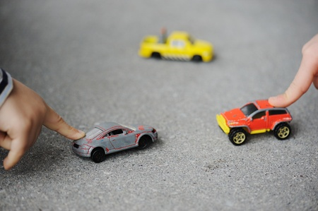 Innocence, childhood concept - playing with toy car photo