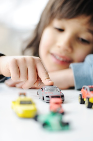 Innocence, childhood concept - playing with toy car Stock Photo - 9216842