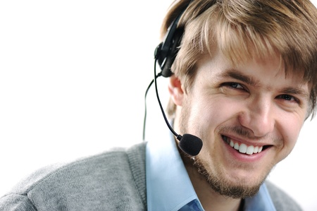support services: Attractive blond support person, male, smilling