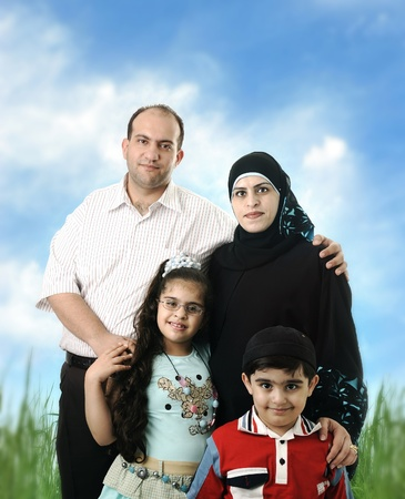 Muslim Arabic family of four members outdoor photo