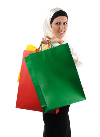 Beautiful Muslim traditional but modern woman holding shopping bags photo