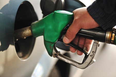 Man refilling the car with fuel on a filling station photo