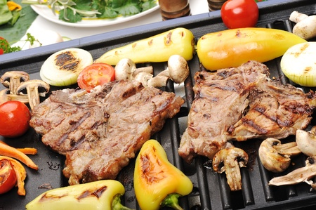 kabab: Barbecue, prepared beef meat and different vegetables and mushrooms on grill
