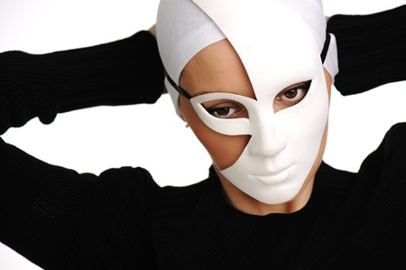 Portrait of a beautiful girl with white mask photo