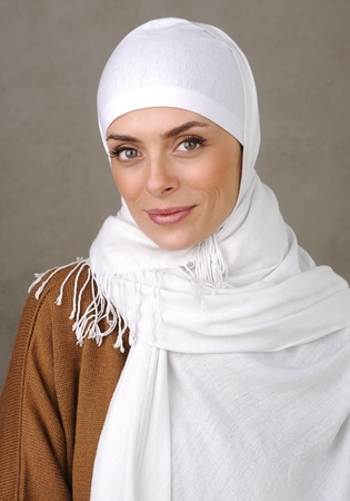 Beautiful Muslim positive woman smiling portrait photo
