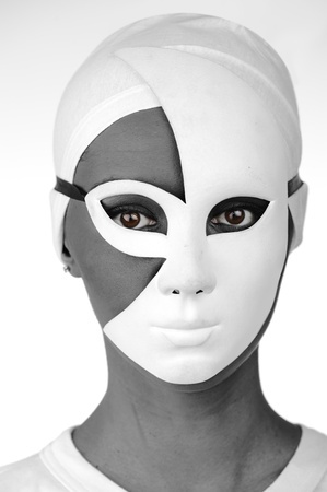 Portrait of a beautiful black girl with white mask