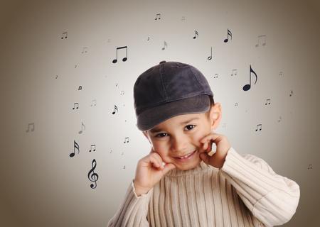 boy with denim cap singing  photo