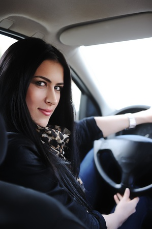 Woman Sitting In Car And Driving photo