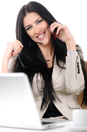View of beautiful business woman holding cell phone and speaking on Stock Photo - 10087166