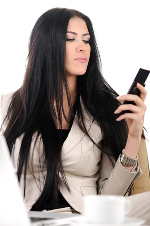 View of beautiful business woman holding cell phone and speaking on photo
