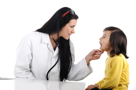 depressor: Female doctor examining child with tongue depressor