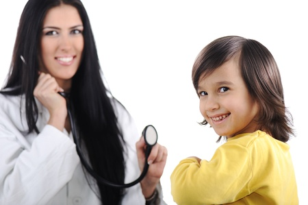 abdomen yellow jacket: Young female doctor examining little cute child at modern hospital