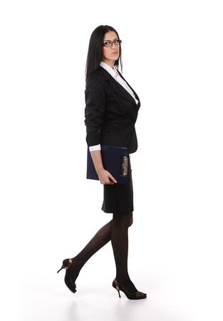 business woman walks on heels with documents in hands, isolated photo