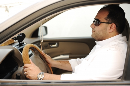 Arabic man driving a car photo