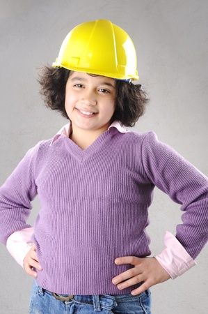 LIttle master girl engineer with helmet photo