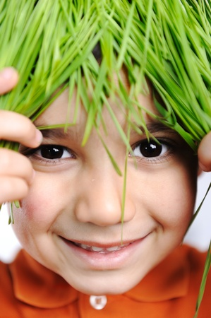 Cute happy kid with grass hair photo