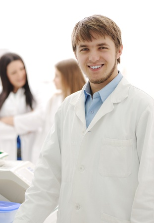 group of scientists working at the laboratory, young doctor smiling at camera Stock Photo - 10087072