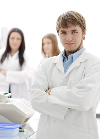Group of scientists standing  at the laboratory, young doctor with folded arms Stock Photo - 10087042