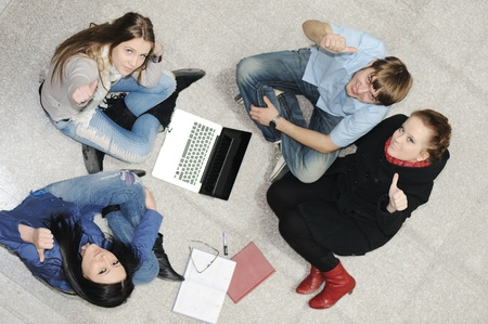 Creative group of students sitting and working together photo