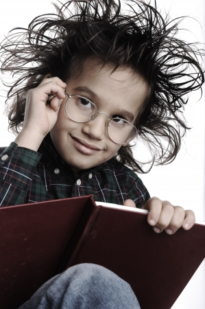 crazy hair: Smart nerd kid with glasses and funny hair writing