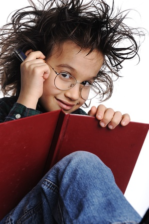 genius: Smart nerd kid with glasses and funny hair writing