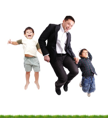 latino man: Father and sons  jumping over green grass, isolated