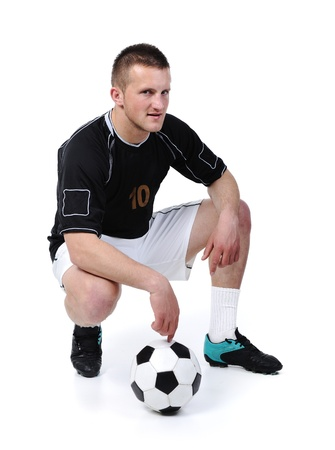 athletic gear: Football player is holding ball isolated on white Stock Photo