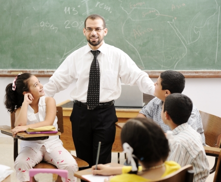 child classroom: Education activities in classroom at school, happy children learning Stock Photo