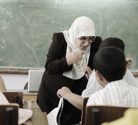 punish: Education activities in classroom,  female teacher yelling at pupil Stock Photo