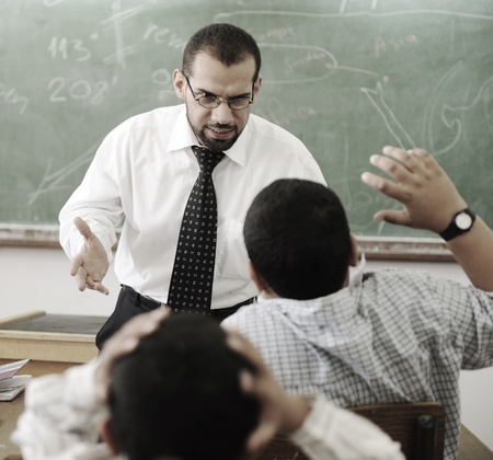 behaviors: Education activities in classroom,   teacher yelling at pupil Stock Photo