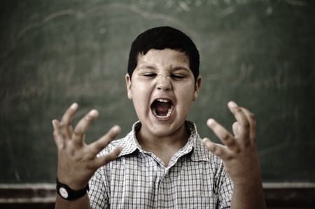 Furious mad pupil at school yelling photo
