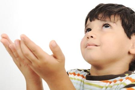islamic pray:  little muslim kid is praying on traditional way