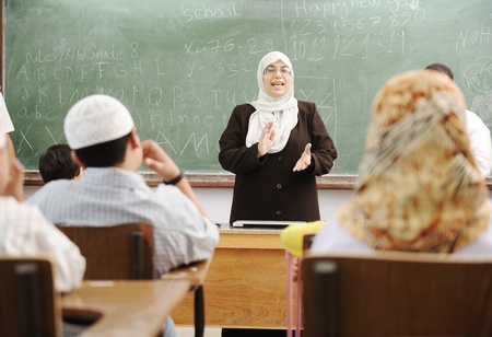 arab people: Education activities in classroom at school, happy children learning Stock Photo