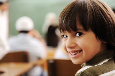 boy arabic: Education activities in classroom at school, happy children learning Stock Photo
