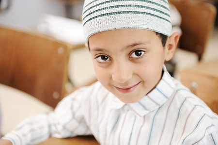 learning arabic: Education activities in classroom at school, happy children learning Stock Photo