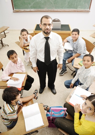 all smiles: Education activities in classroom at school, happy children learning Stock Photo