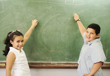 arab girl: Education activities in classroom at school, happy children learning Stock Photo