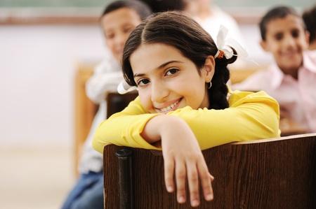 arab teen: Education activities in classroom at school, happy children learning Stock Photo