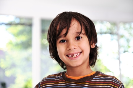 tooth fairy: Happy cute boy without front tooth, prepared for the school