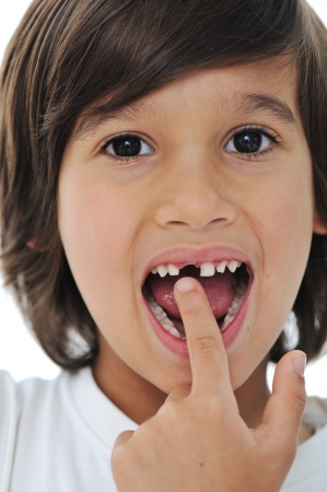 Lost milk tooth, cute boy with long hair Stock Photo - 10290777
