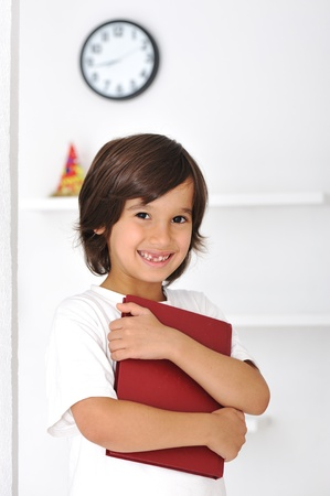Happy cute boy with long hair indoor Stock Photo - 10290179
