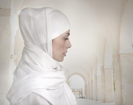 woman face profile: Beautiful Muslim woman isolated on white, profile