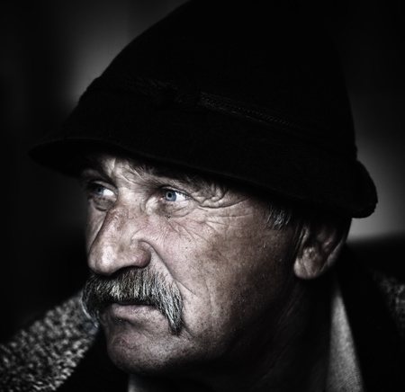 60 years old: Closeup Artistic Photo of Aged Man With  Grey Mustache, grain added Stock Photo
