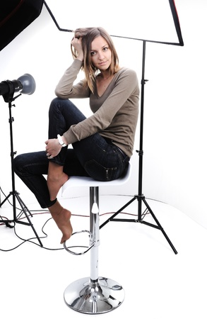 Young beautiful model posing in professionally equipped studio photo