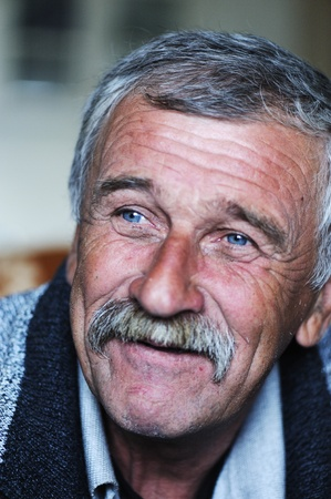 year profile: Common elderly positive man with mustache