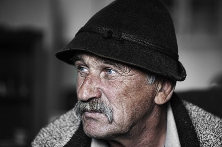 year profile: Portrait of old man with mustache, grain added
