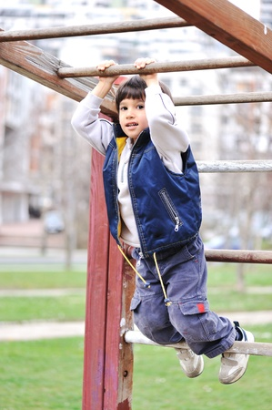 Boy climbing stairs od playground photo