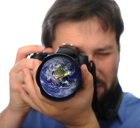 zoom earth: Earth in camera lens, man shooting photo